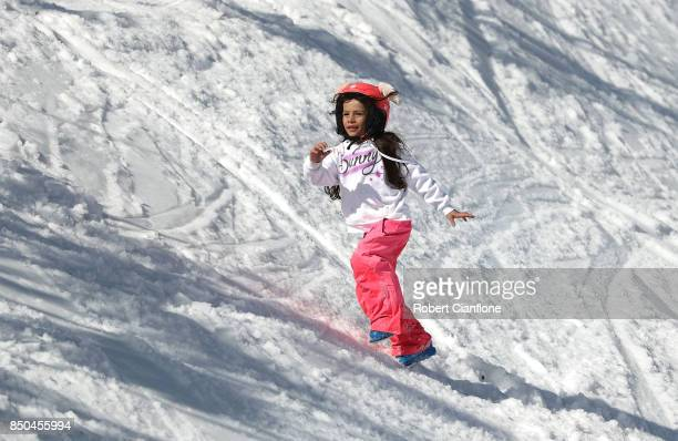 A young girl plays in the snow on September 21 2017 in Mount Buller Australia Australians are enjoying one of the best ski seasons after the best...