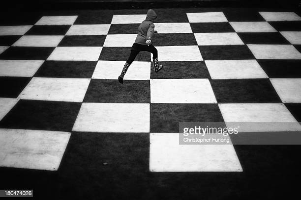 A young girl plays on the human chess board from cult TV series The Prisoner during Festival No 6 on September 13 2012 in Portmeirion United Kingdom...