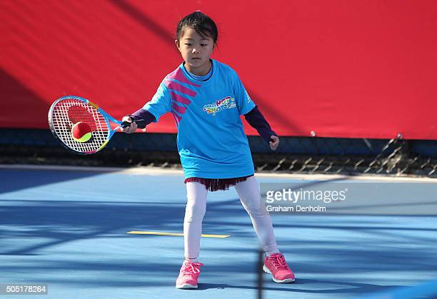 A young girl plays tennis during Kids Tennis Day presented by Nickelodeon ahead of the 2016 Australian Open at Melbourne Park on January 16 2016 in...