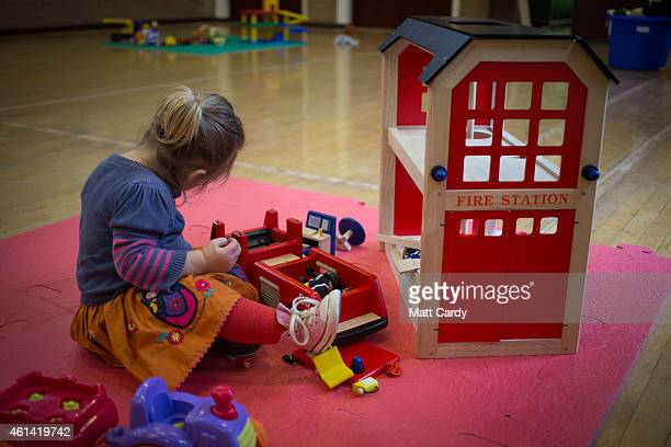 A young girl plays with toys at a playgroup for preschool aged children in Chilcompton near Radstock on January 6 2015 in Somerset England Along with...