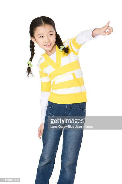 Young girl pointing away