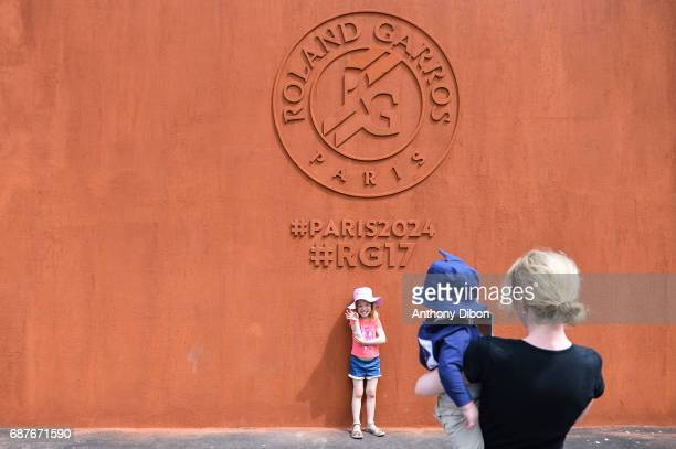 A young girl pose for a picture during qualifying match of the 2017 French Open at Roland Garros on May 24 2017 in Paris France