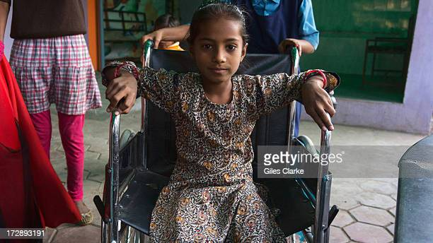 A young girl poses for a portrait at the Chingari Trust's rehab center for children November 30 2012 in Bhopal India The Chingari Trust serves as a...