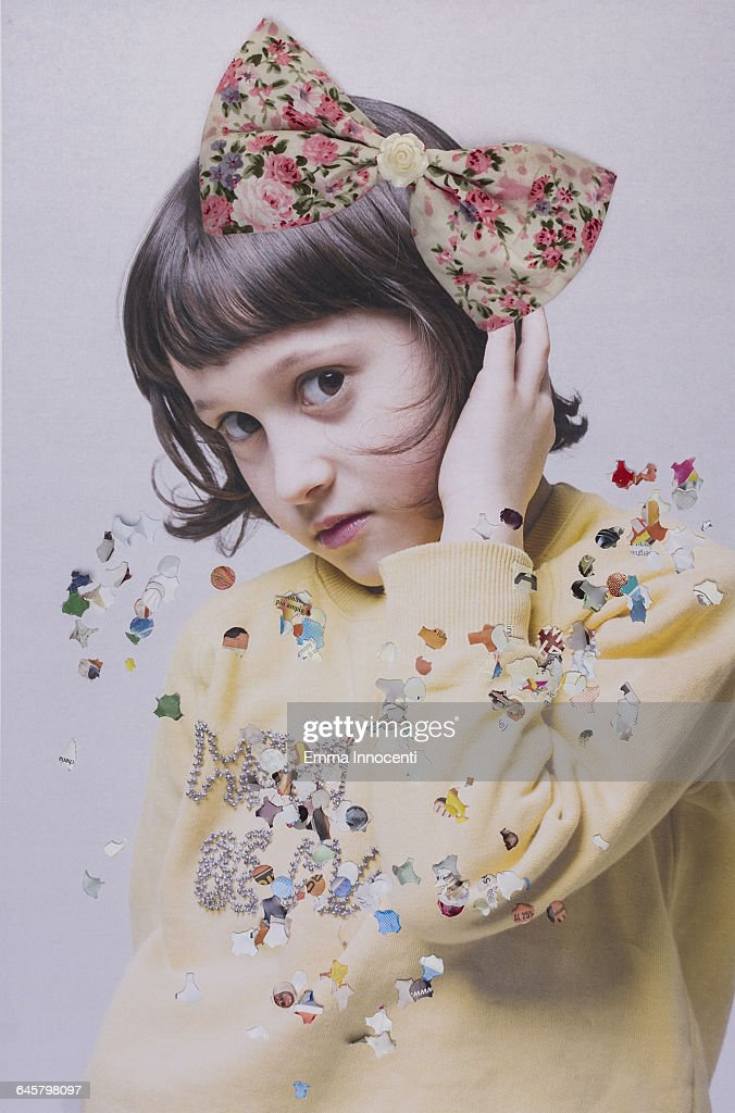 young girl poses with bow on her hair