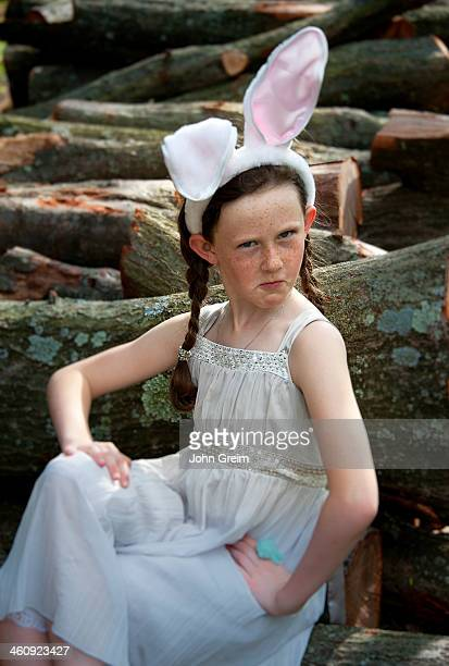 Young girl posing with Easter dress and bunny ears