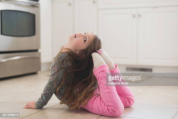 Young girl practicing ballet poses