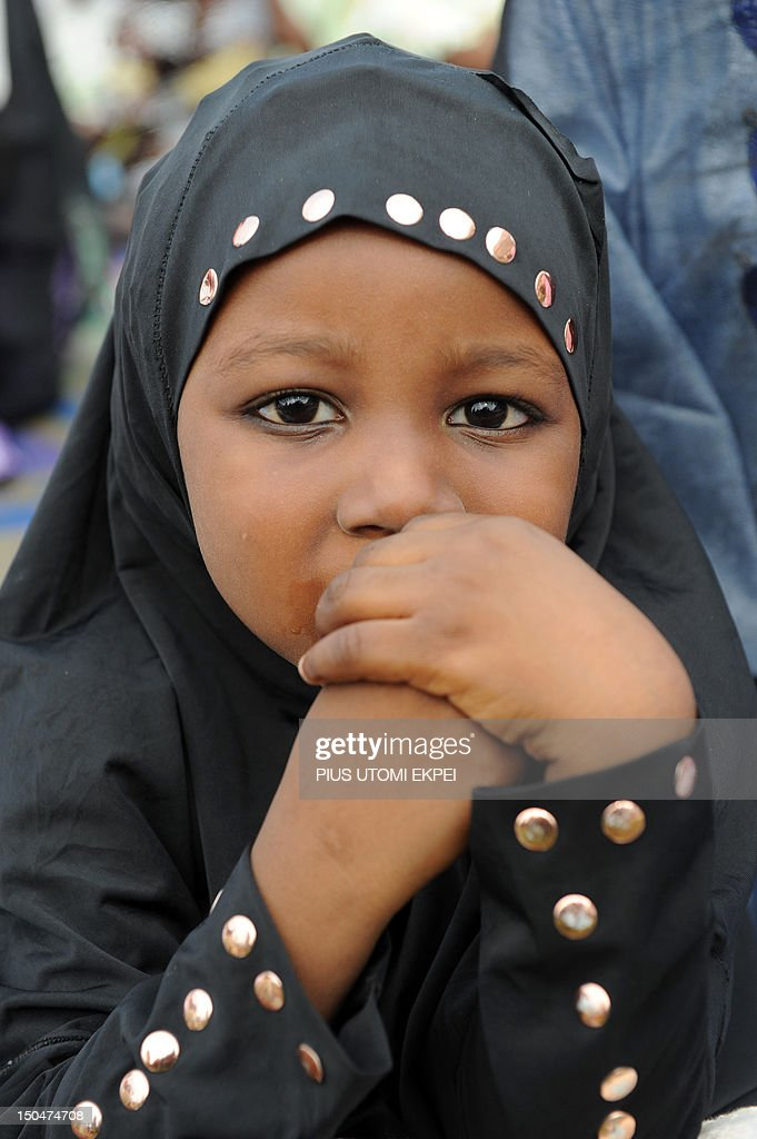 A young girl prays on the first day of Eid al-Fitr at Obalende praying ground in Lagos on August 19, 2012. Muslims around the world celebrate Eid al-Fitr, marking the end of Ramadan, the Muslim calendar's ninth and holiest month during which followers are required to abstain from food, drink and sex from dawn to dusk.