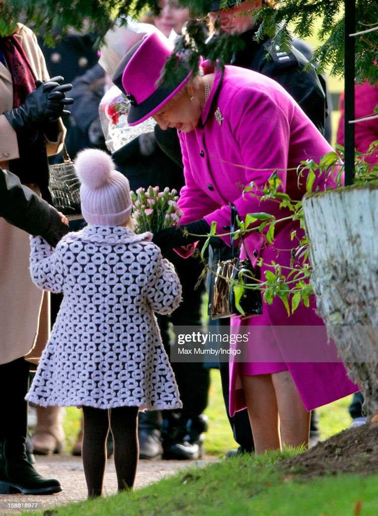 A young girl presents Queen <a gi-track='captionPersonalityLinkClicked' href=/galleries/search?phrase=Elizabeth+II&family=editorial&specificpeople=67226 ng-click='$event.stopPropagation()'>Elizabeth II</a> with a bunch of flowers as she leaves St. Mary Magdalene Church, Sandringham after attending Sunday service on December 30, 2012 near King's Lynn, England.