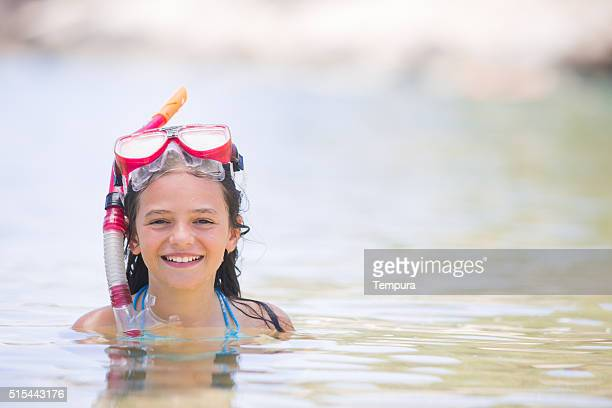 Young girl ready for snorkelling in an idilic island.
