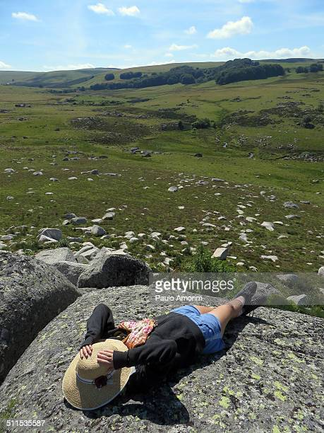 A young girl relaxes at mountain