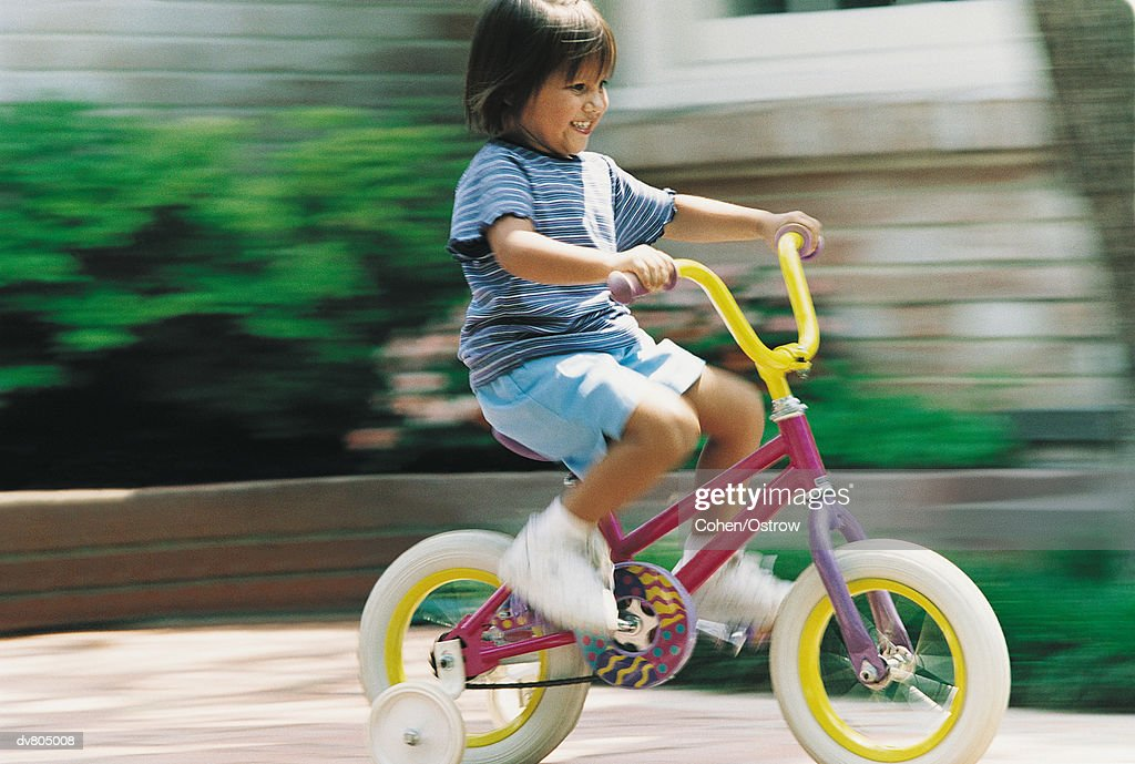 Young Girl Riding a Bicycle : Stock Photo