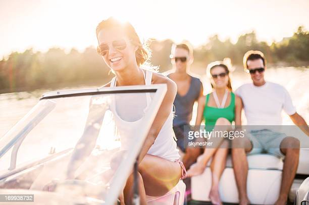 Young girl riding a speedboat.