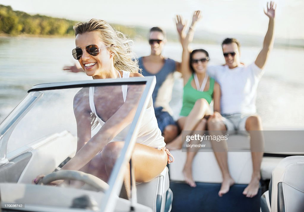 Young girl riding a speedboat