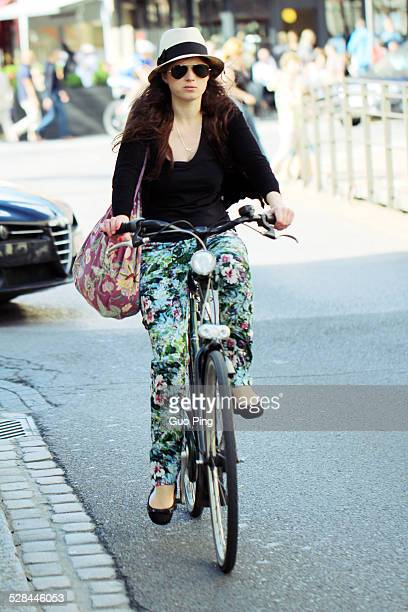 A young girl riding bicycle On the street in Antwerp Belgium