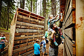 Young girl riding on camp counselors shoulders