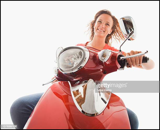 Young girl (16-17) riding scooter