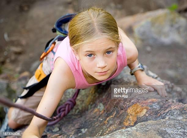 Young Girl Rock Climbing