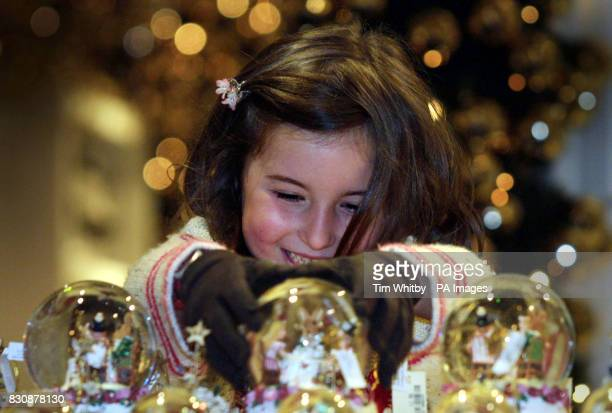A young girl Rosie Kramer examines the Christmas decorations in Christmas World which opened today at Harrods