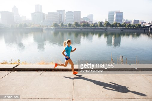 A young girl running for exercise. : Foto stock