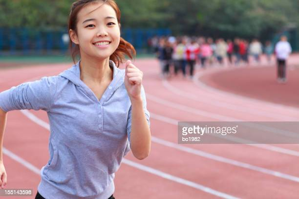 young girl running in track