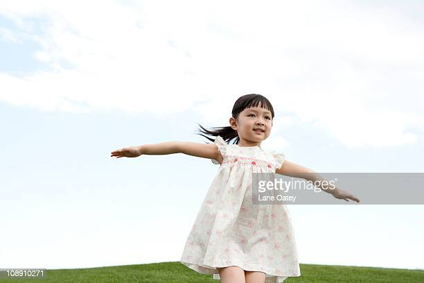 Young girl running outdoors