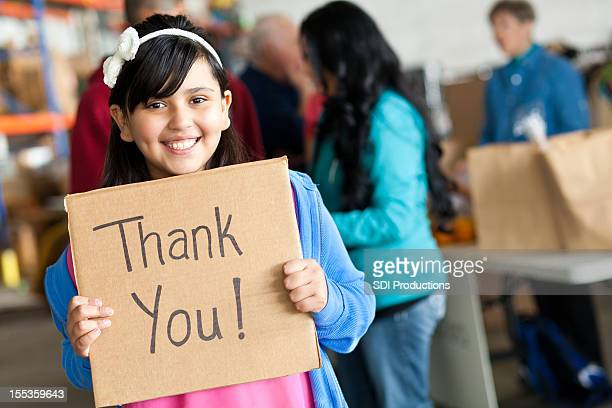 Young girl saying Thank You at a donation center