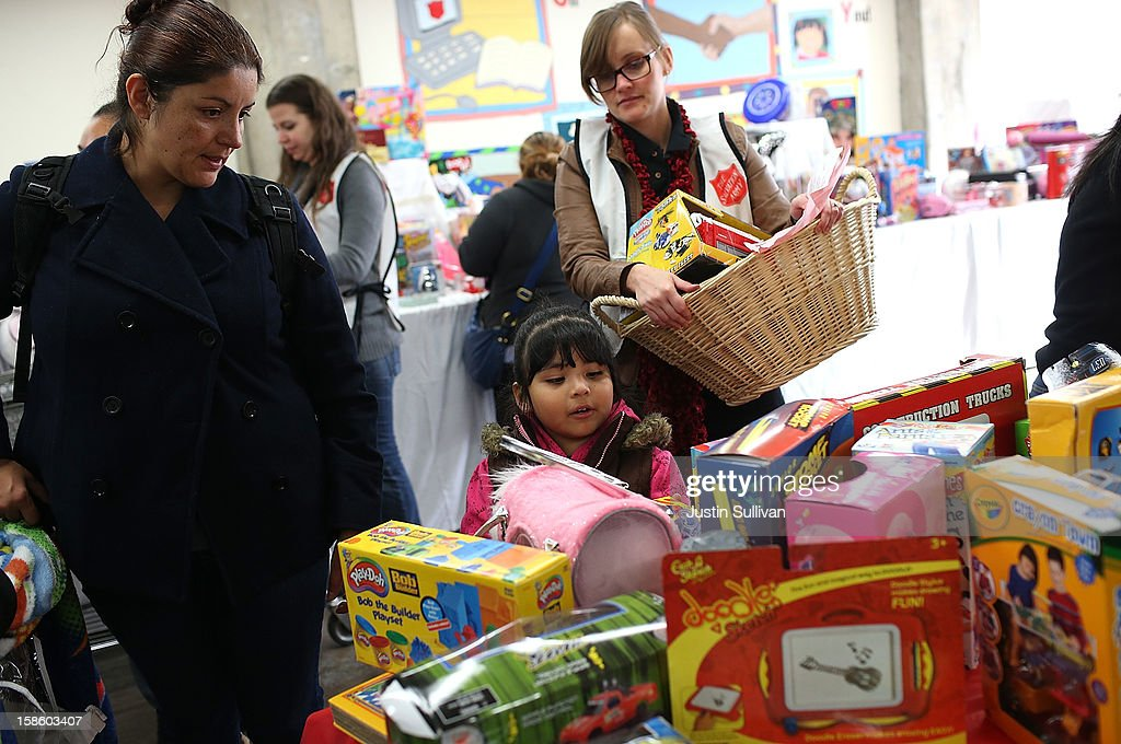 A young girl shops for toys during the Salvation Army's Toy & Joy Shop Distribution on December 20, 2012 in San Francisco, California. With less than one week before Christmas, the Salvation Army's Golden State division held a Toy & Joy Shop Distribution event that allows families in need to shop for free toys and receive a bag with ingredients to make a holiday meal. Nearly 1,500 families will attend the two day event.