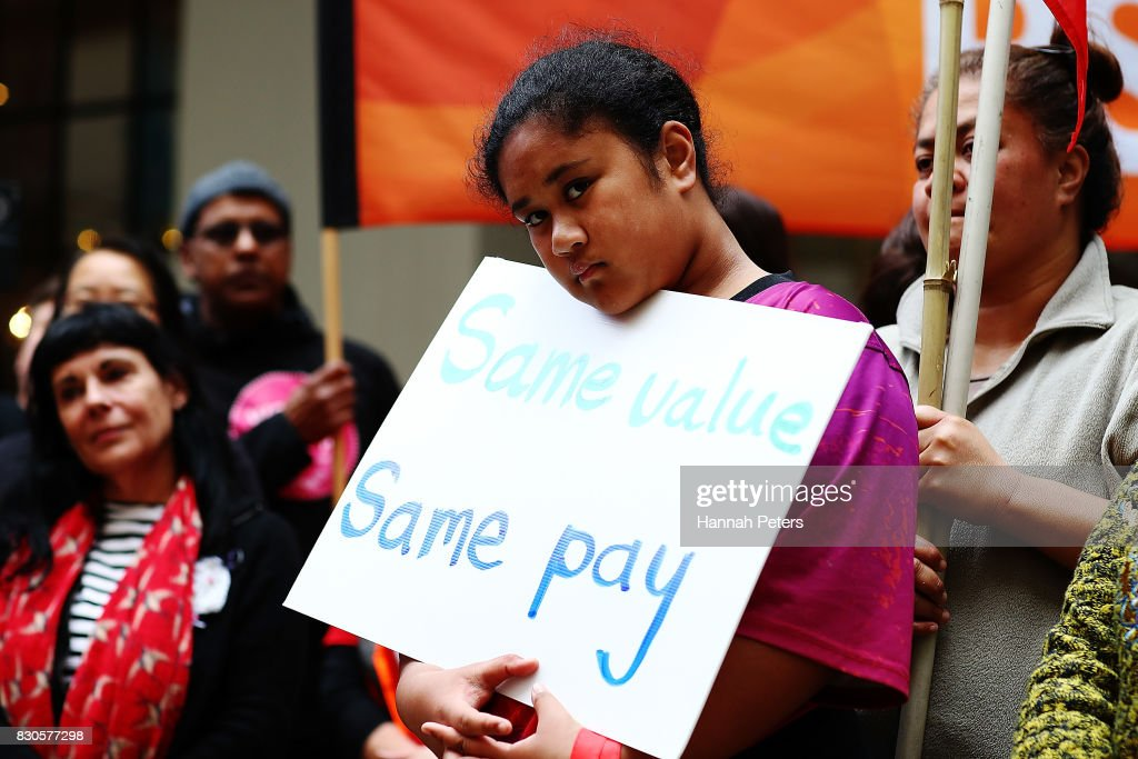 A young girl show her support during a rally for pay equity in New Zealand on August 12, 2017 in Auckland, New Zealand. Opposition MPs and members of the public are protesting against the government's Pay Equity Bill ahead of its anticipated first reading in parliament on Tuesday.