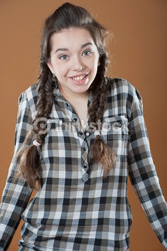 young girl shrugs stock photo thinkstock