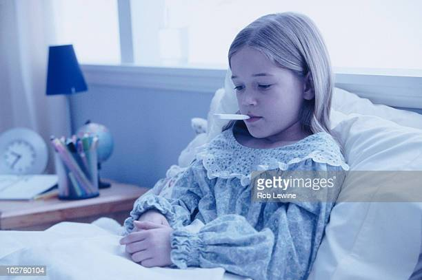 Young girl sick in bed