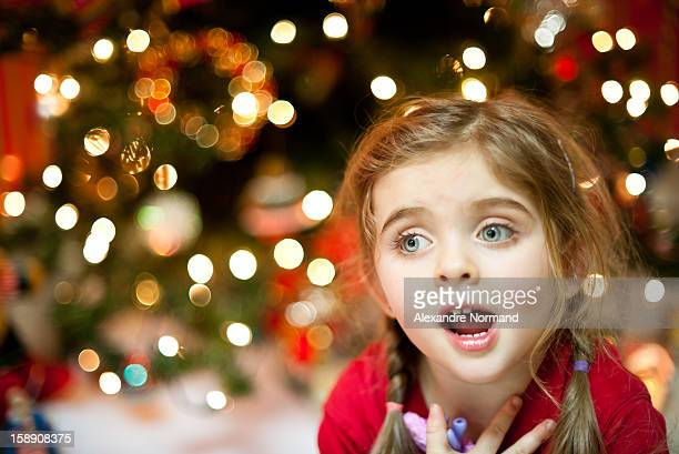 Young girl singing Christmas Carol