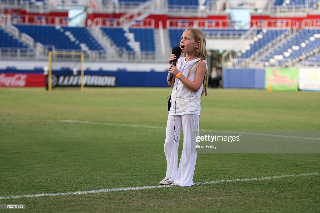 A young girl sings the National Anthem before the between the Florida Launch and the Boston Cannons game at FAU Stadium on June 20 2015 in Boca Raton...