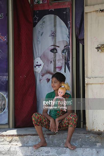 A young girl sits on a step with her doll on June 15 Gaza City Gaza The devastation across Gaza can still be seen nearly one year on from the 2014...