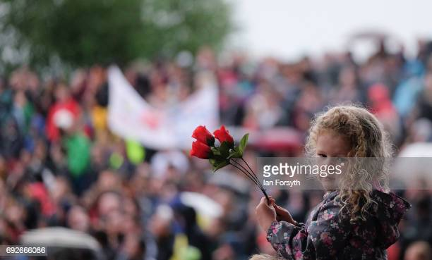 A young girl sits on her father's shoulders as Labour Leader Jeremy Corbyn delivers a speech to thousands at a rally next to the Sage building on...