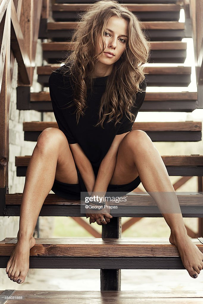 Young girl sitting in the stairs