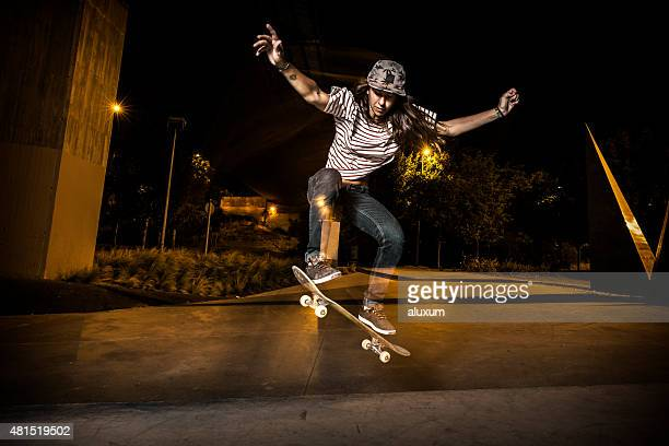 Young girl skateboarder jumping