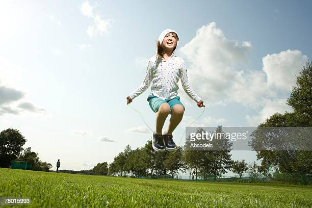 Young Girl skipping in grass