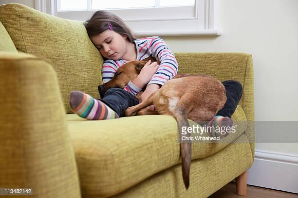 Young girl sleeping with her dog