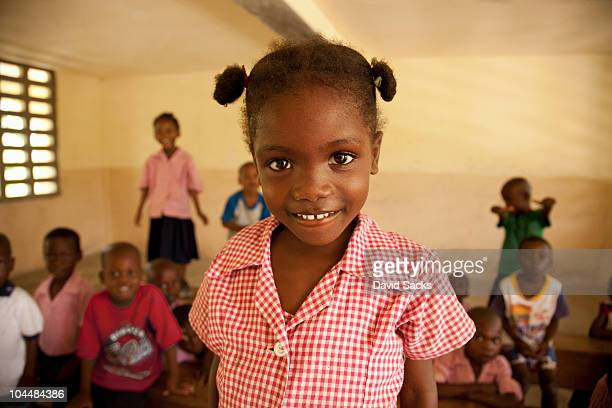 Young girl smiling at school