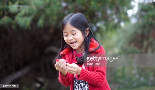 Young girl smiling outdoor : Stock Photo
