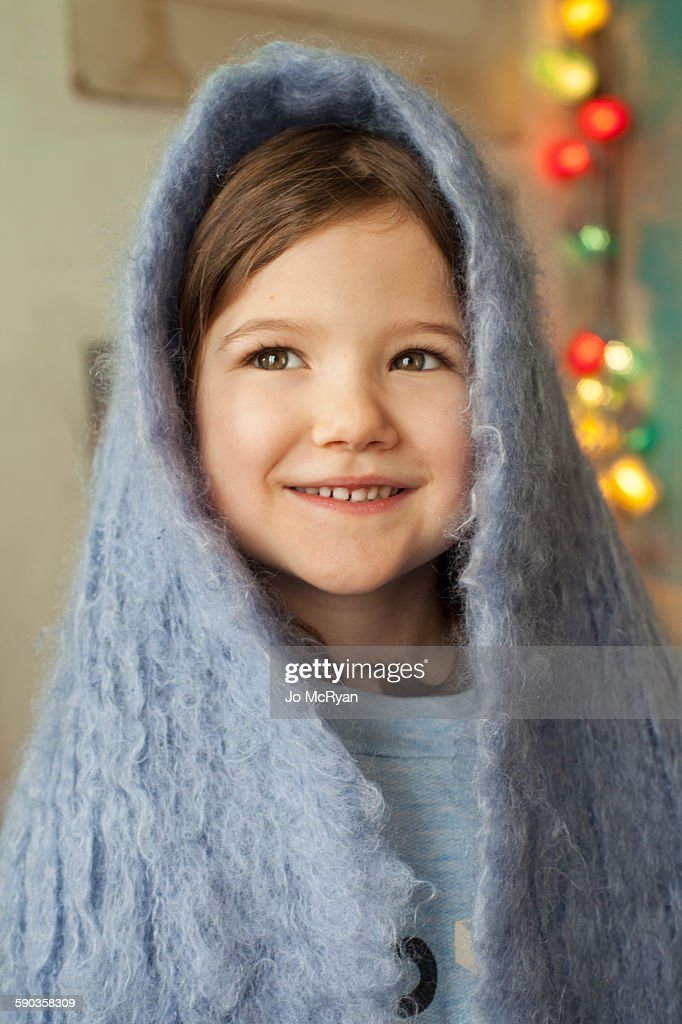 Young Girl Smiling, wrapped in blanket