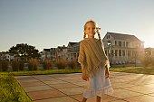 Young girl standing in backyard