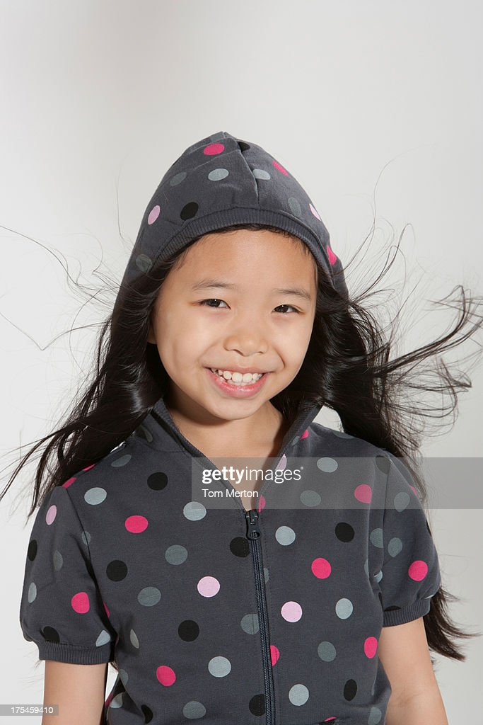 Young girl standing indoors : Stock Photo
