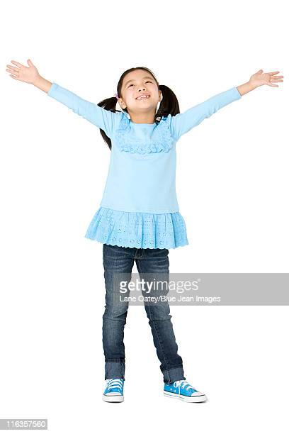 Young girl standing with arms outstretched