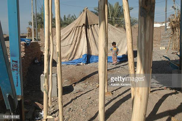 A young girl stands outside a tent where her family has been camping for almost a year after a major earthquake struck the city Bam Iran 6th November...