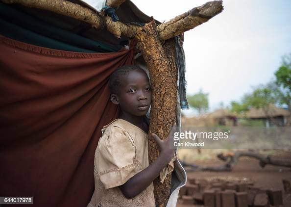 A young girl stands outside her shelter at the Bidi Bidi refugee camp on February 22 2017 in Arua Uganda The continued flow of refugees from South...