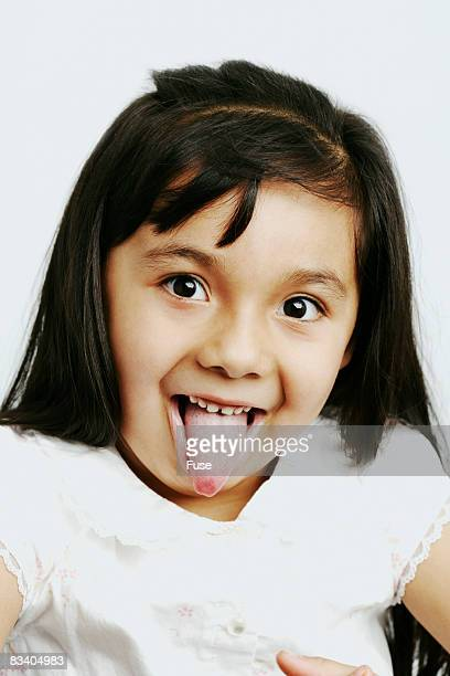 Young Girl Sticking out Tongue