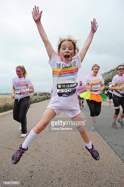 A young girl takes part in The Color Run presented by Dulux known as the happiest 5km on the planet on September 14 2013 in Brighton England Runners...