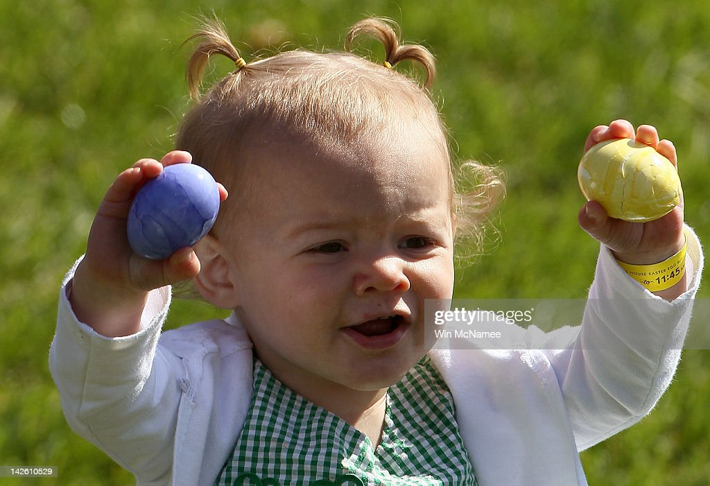 A young girl takes part in the White House Easter Egg Roll on the South Lawn of the White House April 9, 2012 in Washington, DC. Thousands of people people are expected to attend the 134-year-old tradition of rolling colored eggs down the White House lawn that was started by President Rutherford B. Hayes in 1878.