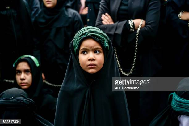 TOPSHOT A young girl takes part with Turkish Shiite women in a religious procession held for the Shiite religious holiday of Ashura on September 30...